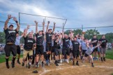All celebrate the Men In Black softball game in Endicott on Sunday. The priests and seminarians won, 15 to 8, against the parishoners of OLGC and St. Ambrose.