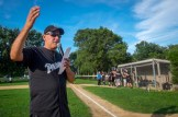 Fr. Michael Galuppi makes introductions before the start of the Men In Black Softball game in Endicott on Sunday.