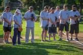 The parishoners of OLGC and St. Ambrose during prayer befor the start of the Men In Black Softball game in Endicott on Sunday.