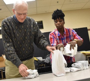 Father Victoria - Jolly volunteers fill goodie bags for inmates
