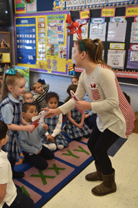 IC candy canes copy - Big buddies guide tykes in IC School's season of giving