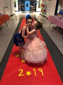 Anna Schafer (kindergarten) and sister Emily (pre-K 3-year-old) on the red carpet.