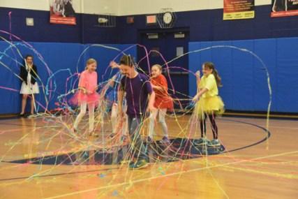 "Second-graders Claire Caltabiano, Patrick Rowland, Caroline Wilson, Katarina Riccelli, and Stefania Fiumara dancing to ""Fireworks"" with confetti fireworks."