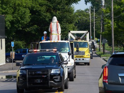 statue in truck with police escort - Icons take trip but still tower over Valley