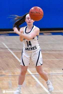 Grimes girl No. 14 passes ball - For high school hoop teams, it's a feverish February