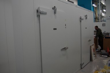 two doors of a large walk-in cooler