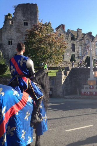 Hay History Weekend and The Battle of Agincourt - French Knight on Horseback leading procession outside Hay Castle