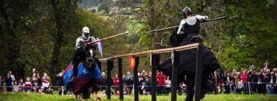 Sudeley Castle Medieval Jousting Display 2017 - Dark Knight against Blue Knight, The Cavalry of Heroes Knights on Horsebackat Sudeley Castle Medieval Jousting Show 2017, Gloucestershire. Family Entertainment for shows and events, with main arena acts and displays