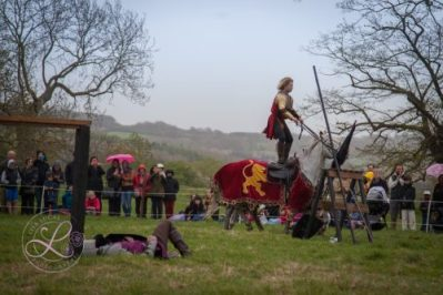 Sudeley Castle Medieval Jousting Show 2017 - The Golden Knight from The Cavalry of Heroes celebrating his victory by roman riding