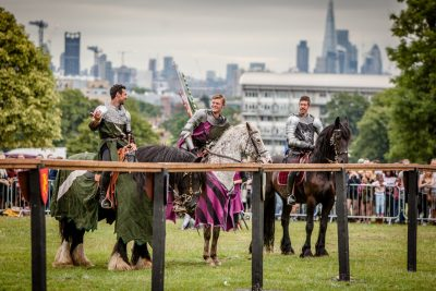 Lambeth Country Show - Brockwell Park - Medieval Jousting Tournament with The Cavalry of Heroes, Knights on Horseback Main Arena Stunt Horse Show 2017 - The Knights joke under the London skyline