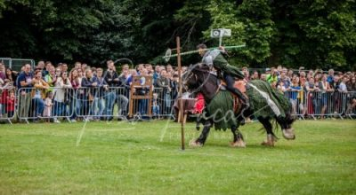 Lambeth Country Show - Brockwell Park - Medieval Jousting Tournament with The Cavalry of Heroes, Knights on Horseback Main Arena Stunt Horse Show 2017 - Sir Agravaine showing off with behind the head jousting
