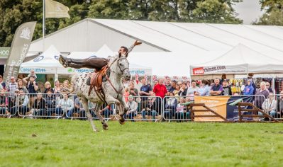 Herefordshire Country Fair - WW1 Horses and Heroes - Trick Riding - Lay across the saddle