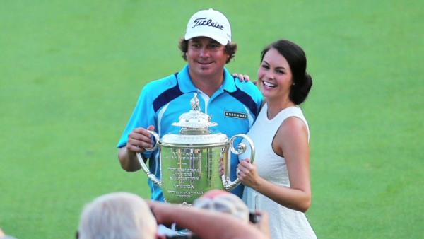 Amanda Boyd and Jason Dufner celebrating championship