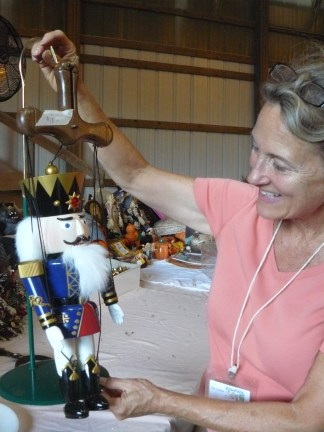 Karen Jeffrey with marionette at rummage sale