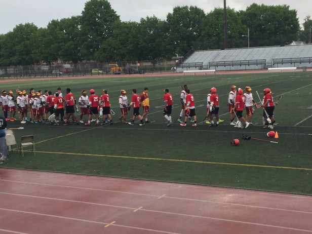 Central's lacrosse players congratulate the opposing team on a game well played. Photo Credit: Kristian Rhim (276)