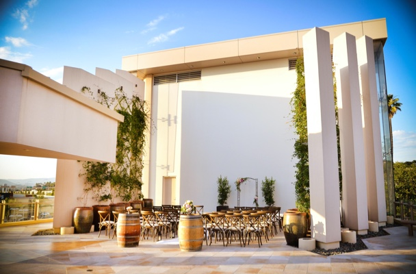 outdoor space with tall columns and architectural elements creating a wall