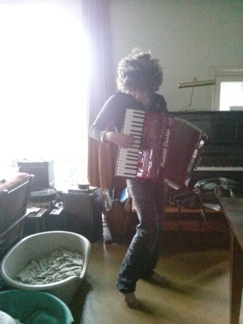 Asher plays the accordian