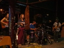 Open mic night at local bar, hostel, restaurant-friends of the world