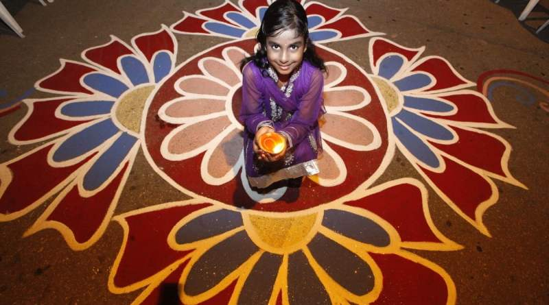 Rangoli Designs for Diwali - Girl sitting in rangoli