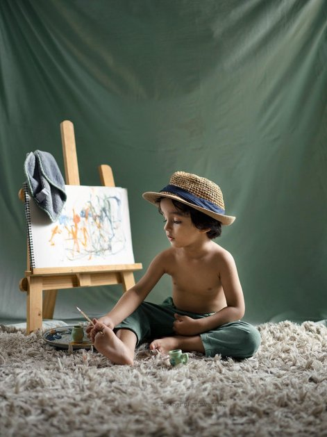 a boy painting on the canvas