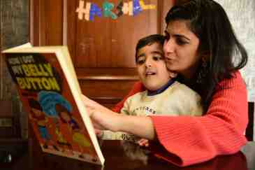 Thought Of The Day For Kids - mother reading to her boy