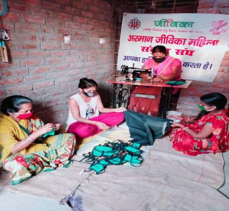 Committed To Care - Women sewing at home