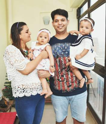 Neha with her husband and twins