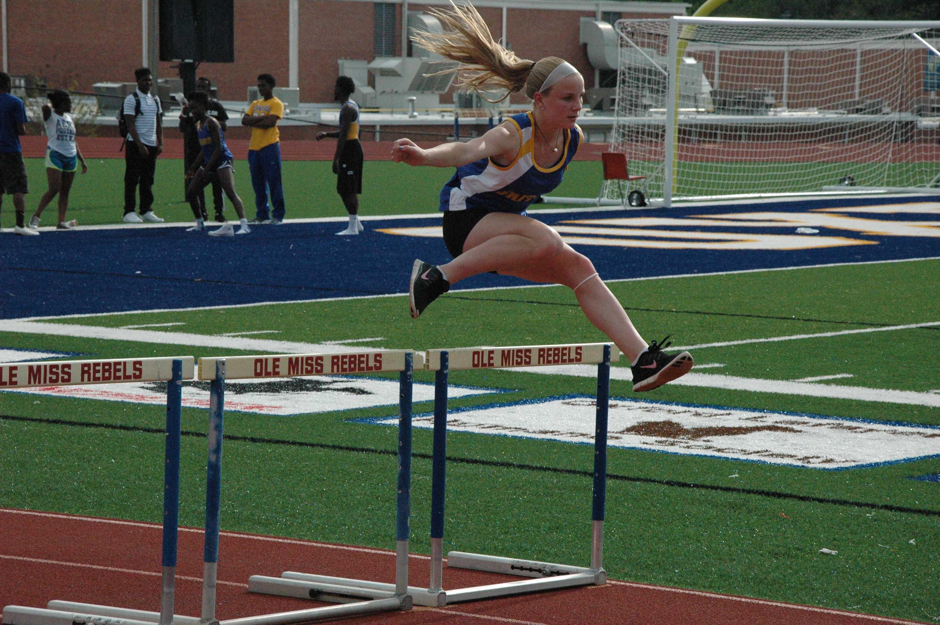 Middle+schooler+Emily+Hayward+practices+before+the+100+meter+hurdles.
