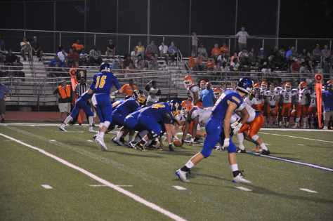 OHS football conquers Trojans on road