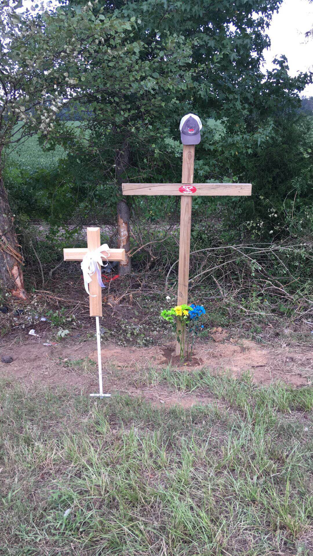 Crosses on the side of Old Sardis Road in memory of Walker Atkinson and his dog, Piper.