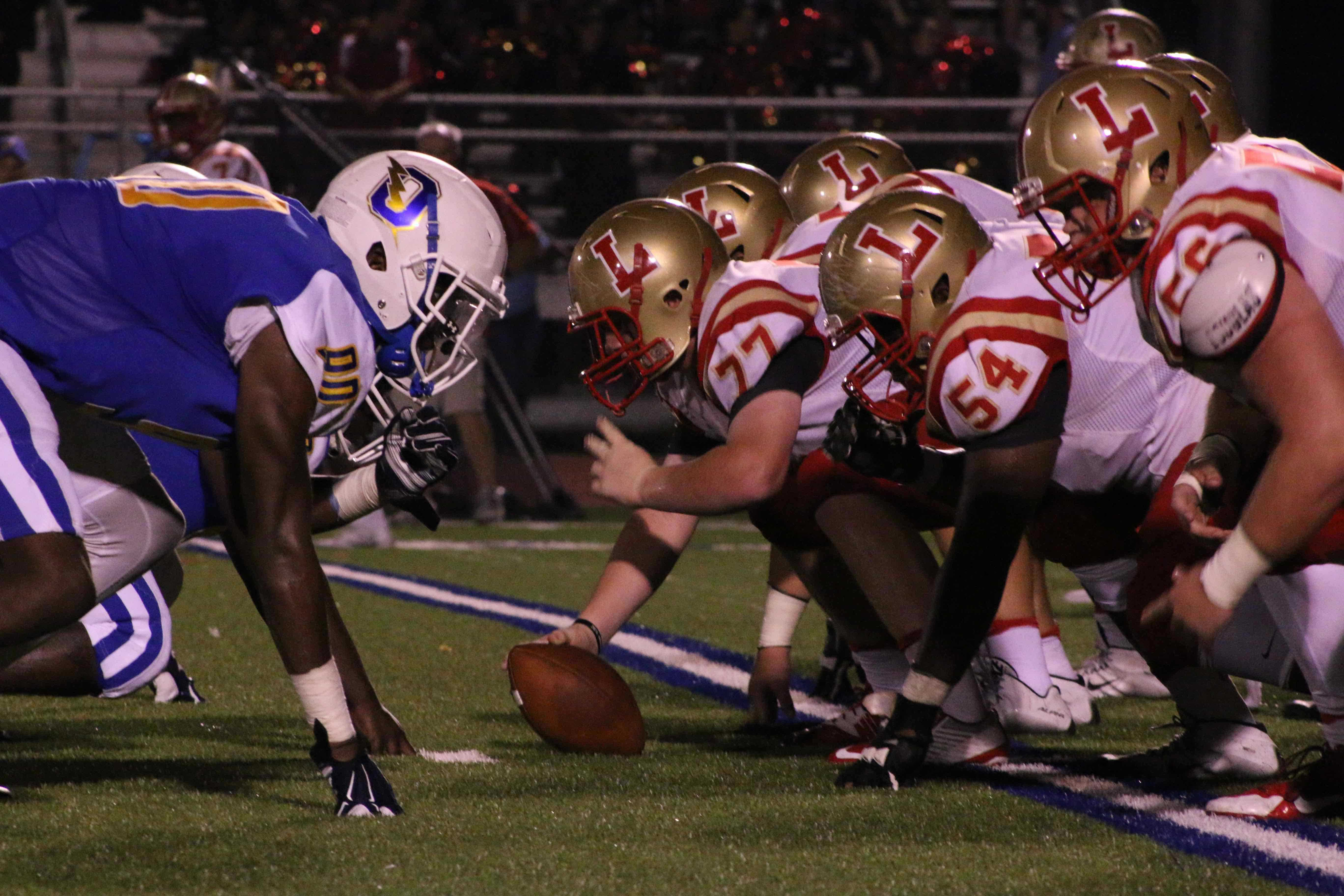 The Charger offensive line lines up across from Lafayette's offensive line.