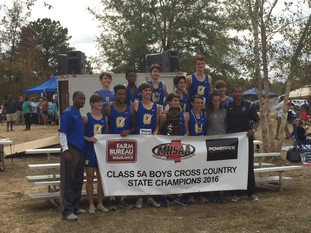 The+OHS+boys+cross+country+team+poses+for+a+picture+after+winning+the+MHSAA+Class+5A+State+Championship.
