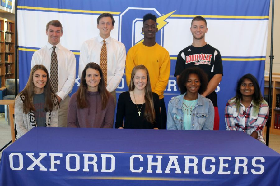 Nine+student-athletes+signed+their+National+Letter+of+Intent+in+the+OHS+Library+on+Wednesday%2C+November+9.