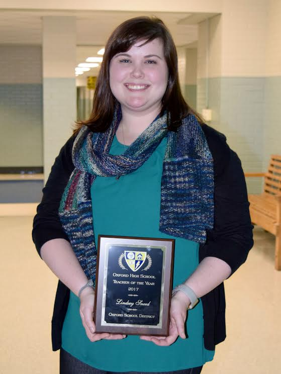 Algebra teacher Lindsey Sneed receives OHS Teacher of the Year award.