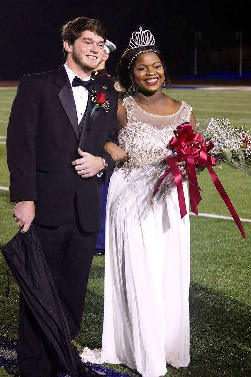 Senior+Samya+Clayton+getting+escorted+by+her+date+after+being+crowned+homecoming+queen+last+October.