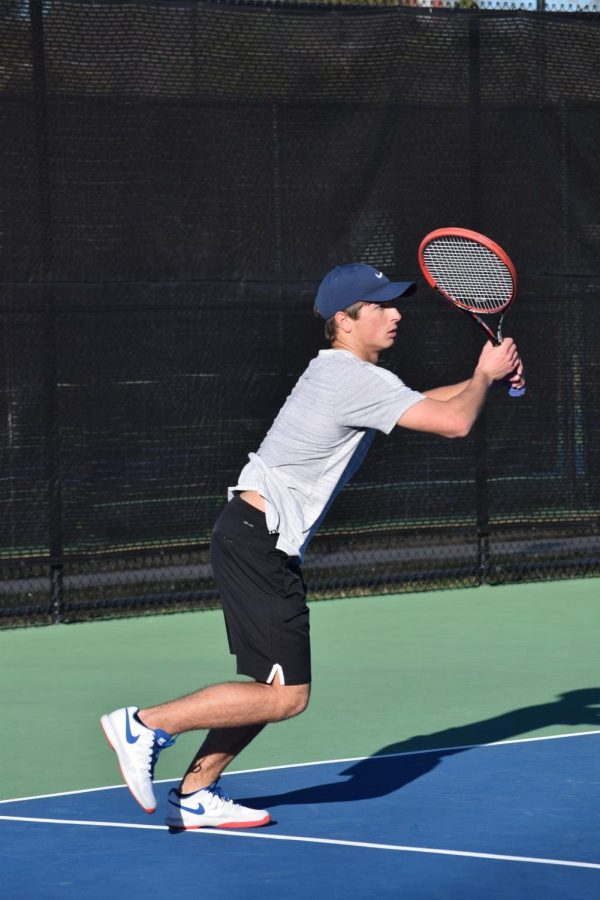 Senior+Ryan+Mounce+serves+up+a+ball+during+practice+at+the+John+Leslie+Tennis+Courts.