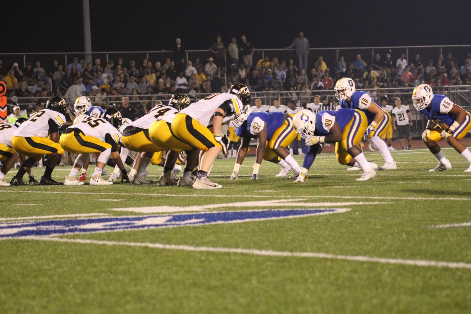 The Charger offense lines up against the Pontotoc defense during last year's meet-up. The Chargers beat the Warriors last year at home with a score of 17-0.