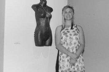 Photo of artist/veteran Lindsay Like at her art exhibition.