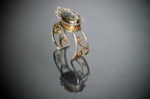"Artist veteran Lindsay Zike's ring : ""Secrets to Keep"" 2014. By <a href=""http://www.zikestudios.com"">Lindsay Zike</a>. Sterling Silver, Fine Silver, Copper, Apache Gold. Photo by James Zike."