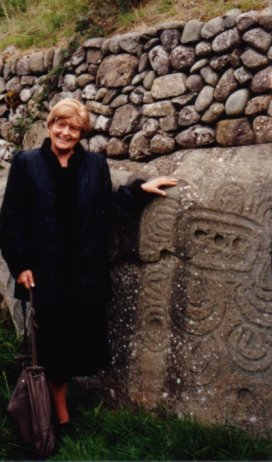 GImbutas at Newgrange in Ireland in front of pictographs on stone