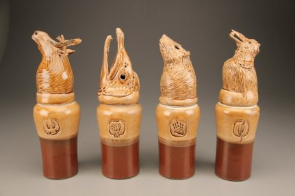 Ceramic Canopic jars with animal heads.For post on importance of local community for artists.