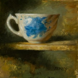 White and blue floral teacup for post on how to start writing your book using tea