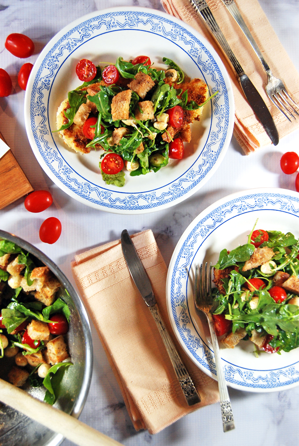Pan-Fried Chicken Paillard with Cherry Tomato Panzanella: An easy, light and healthy panko-crusted chicken paillard with a fresh cherry tomato and mozarella panzanella salad.
