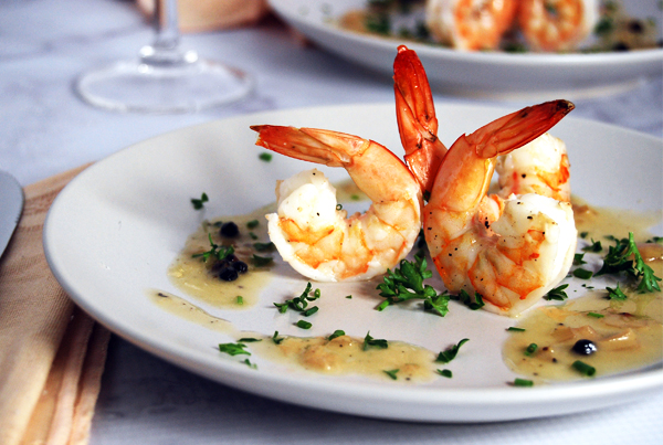 Marinated Shrimp with Champagne Beurre Blanc: Scrumptious marinated shrimp paired with a rich champagne beurre blanc and fresh herbs.