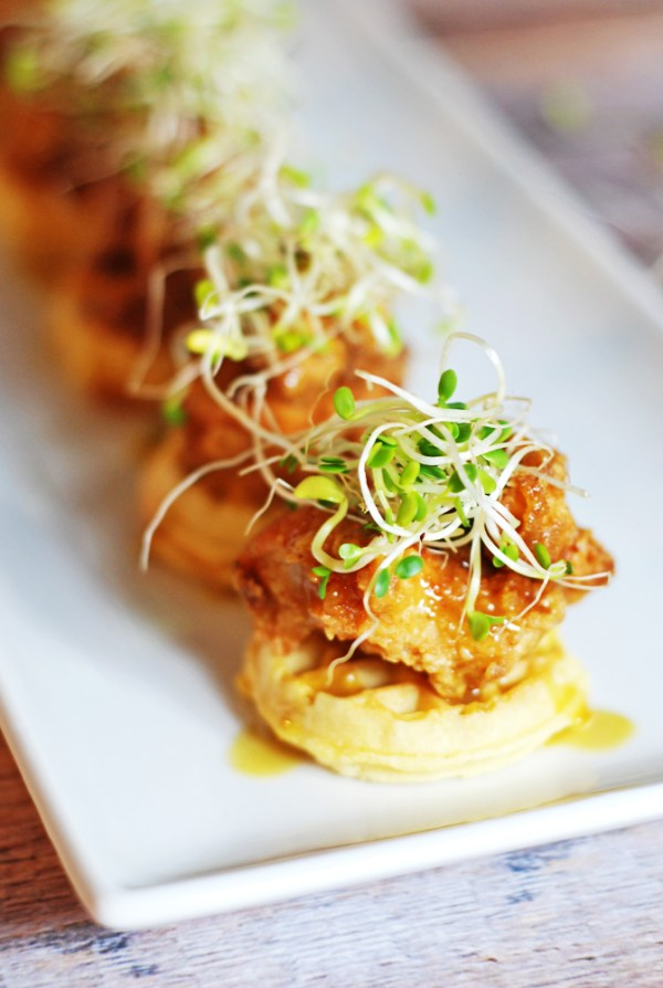 Mini Chicken and Waffles Hors D'oeuvres: A fresh take on a classic southern chicken and waffles dish, featuring mini waffles and a honey dijon syrup sauce.