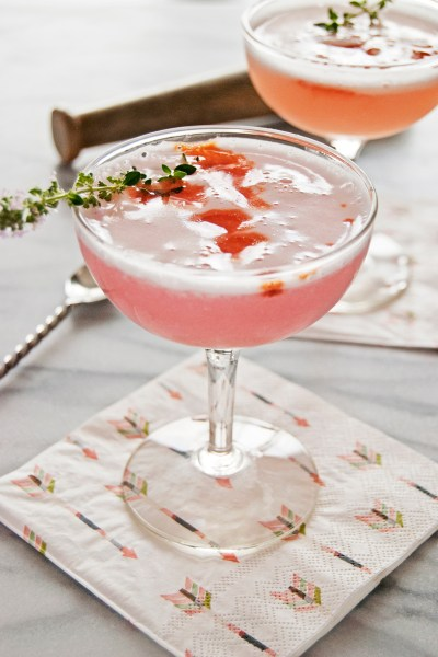 This tasty rhubarb vodka cocktail features DIY rhubarb vodka, a lavender honey simple syrup, lemon juice, and egg white for a frothy delicious drink!