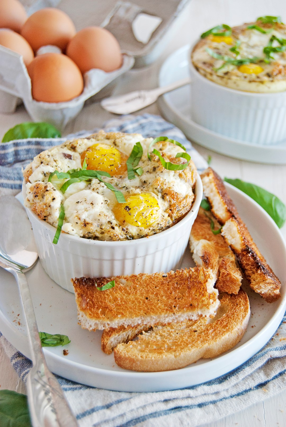 These egg bakes are the perfect simple breakfast, and feature mushrooms, shallots, fresh basil, and tangy goat cheese!