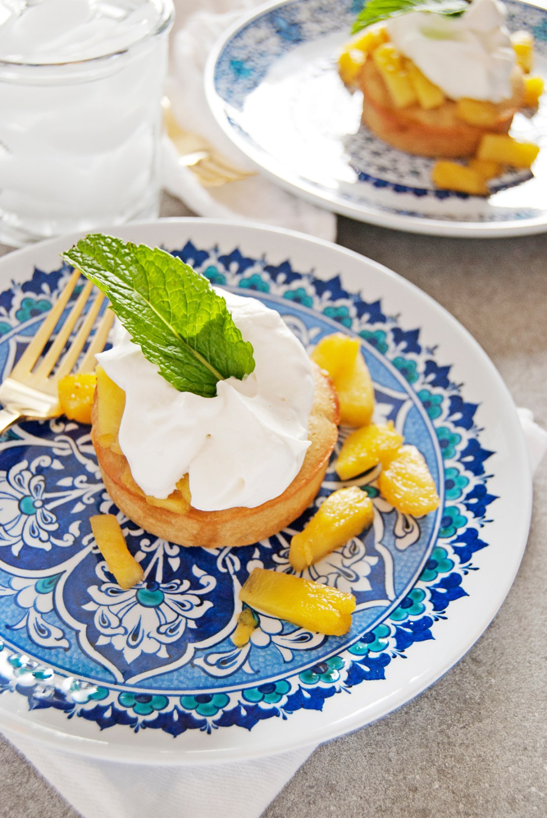 These mini pineapple pound cakes are just too cute! They feature homemade individual pound cakes, topped with pineapple rum sauce and whipped cream.