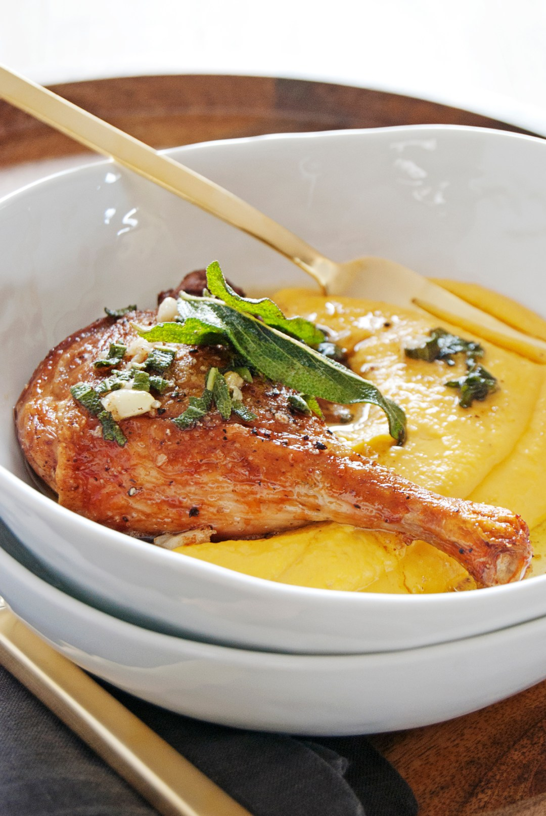 These crispy oven roasted duck legs are paired with a luscious butternut squash mascarpone puree and brown butter sage sauce.