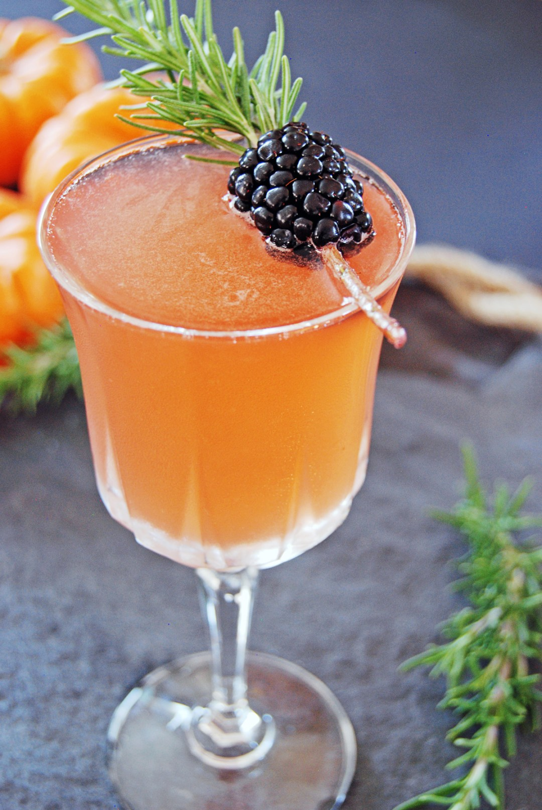 "This Halloween make a ""spooky cocktail"" that is perfect for the fall, with bourbon, blackberry liqueur, and rosemary!"